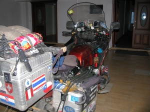 Picture of Bertha in the Hotel sitting on the highly polished wooden floor. She is covered with dust and muck.