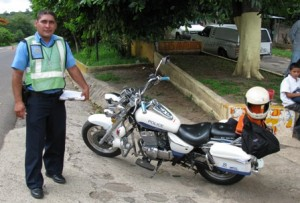 "Picture of a policeman and his motorcycle during one of the many vehicle ""Can I look at your bike"" roadside stops for document checks."