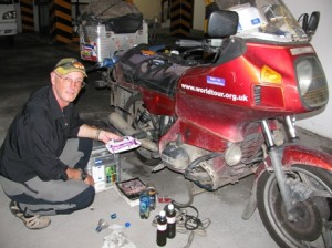 Picture of Bernard working on Bertha in the underground garage at Tuxla.