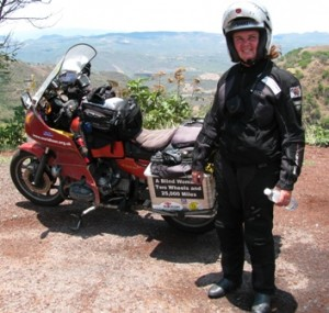 Picture of Cathy standing beside Bertha in the mountains