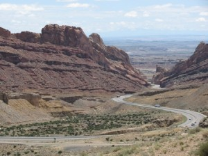 Picture of one of the many canyons we encountered. A road winds its way through the space between the rocky hills.