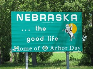 "Picture of a sign in Nebraska which declares ""Nebraska, the good life. Home of Arbor Day."""