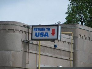 "Picture showing the sign which says ""Return to the USA""."