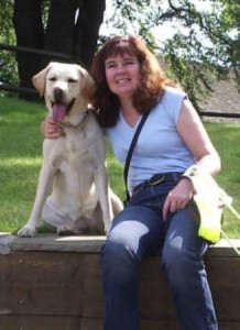 Picture of Cathy sitting with her second guide dog Biscuit