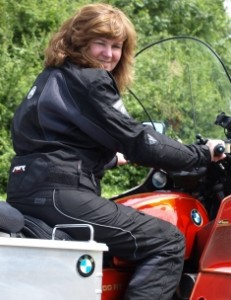Picture of Cathy sitting on the bike looking over her right shoulder