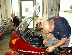 Picture of the technician installing the system on the bike