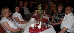 Picture of the friends and family sat at the evening meal.